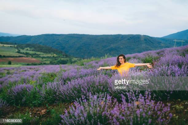 lavender happiness - yellow dress stock pictures, royalty-free photos & images