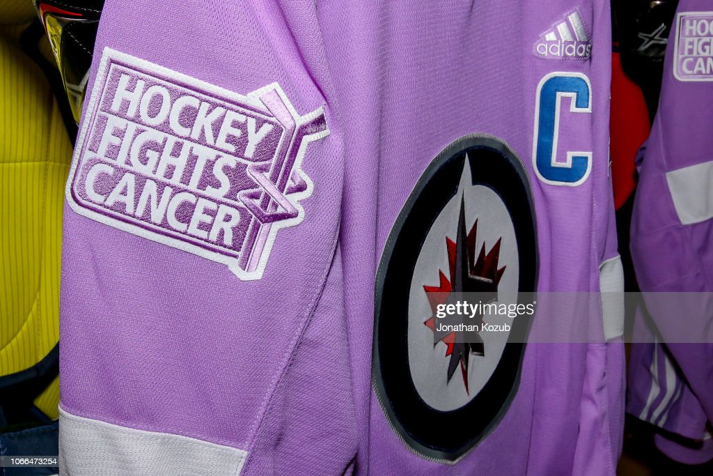 f91208bd1df A lavender jersey for Blake Wheeler of the Winnipeg Jets hangs in ...