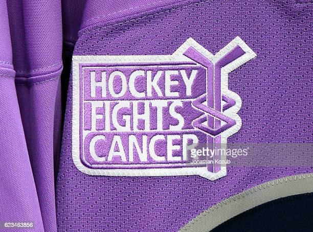 A lavender jersey for Blake Wheeler of the Winnipeg Jets sports the Hockey Fights Cancer logo prior to NHL action against the Chicago Blackhawks at...