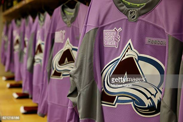 Lavender jerseys hang in the Colorado Avalanche locker room prior to their Hockey Fights Cancer game against the Minnesota Wild at the Pepsi Center...