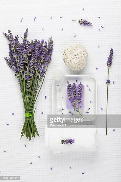 Lavender (Lavendula), white towel, lavender soap on soap basket and natural pumice stone