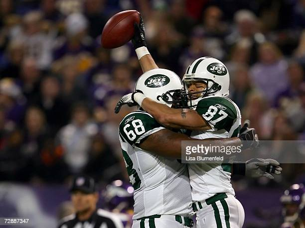 Laveranues Coles of the New York Jets celebrates with teammate Anthony Clement after scoring a touchdown against the Minnesota Vikings on December 17...
