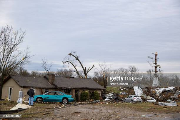 Lavern and Judy Hix survey their home damaged by high winds from one of several tornadoes that tore through the state overnight on March 3 2020 in...