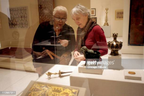 Laverne Alexander and Carol Schneider look over an exhibit of Islamic art at the University of Chicago on March 8 in Chicago Illinois