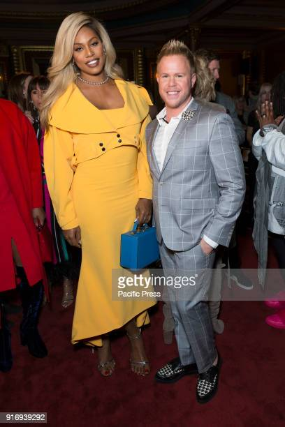 Laverne Cox and Andrew Werner attend Christian Siriano 10 years anniversary Autumn/Winter 2018 runway show at The Grand Masonic Lodge