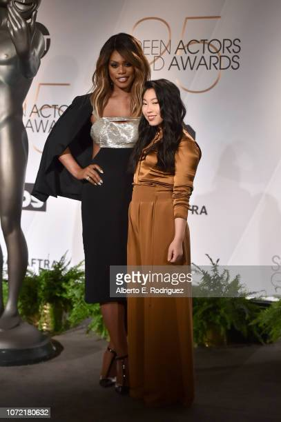Laverne Cox and Awkwafina pose onstage during the 25th Annual Screen Actors Guild Awards Nominations Announcement at Pacific Design Center on...