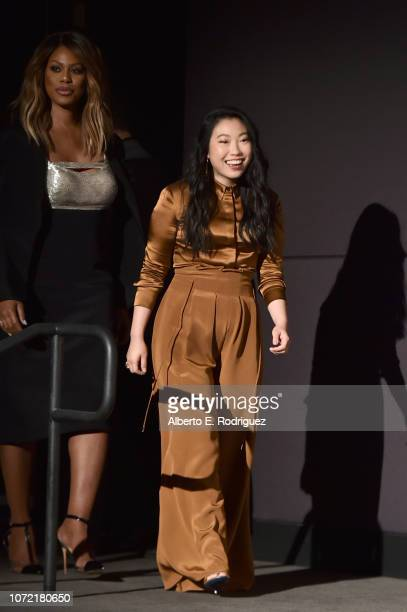 Laverne Cox and Awkwafina walk onstage during the 25th Annual Screen Actors Guild Awards Nominations Announcement at Pacific Design Center on...