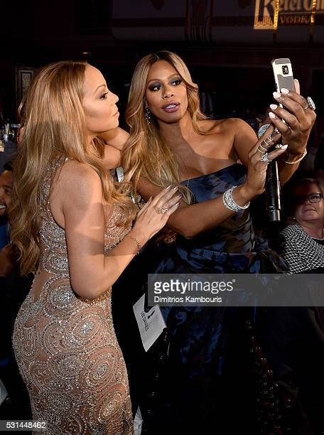 Laverne Cox and Mariah Carey pose backstage at the 27th Annual GLAAD Media Awards in New York on May 14 2016 in New York City