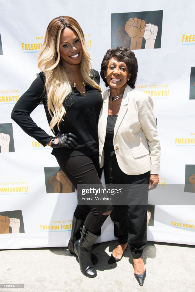 Laverne Cox (L) and Maxine Waters attend 'Families Belong Together - Freedom for Immigrants March Los Angeles' at Los Angeles City Hall on June 30, 2018 in Los Angeles, California.