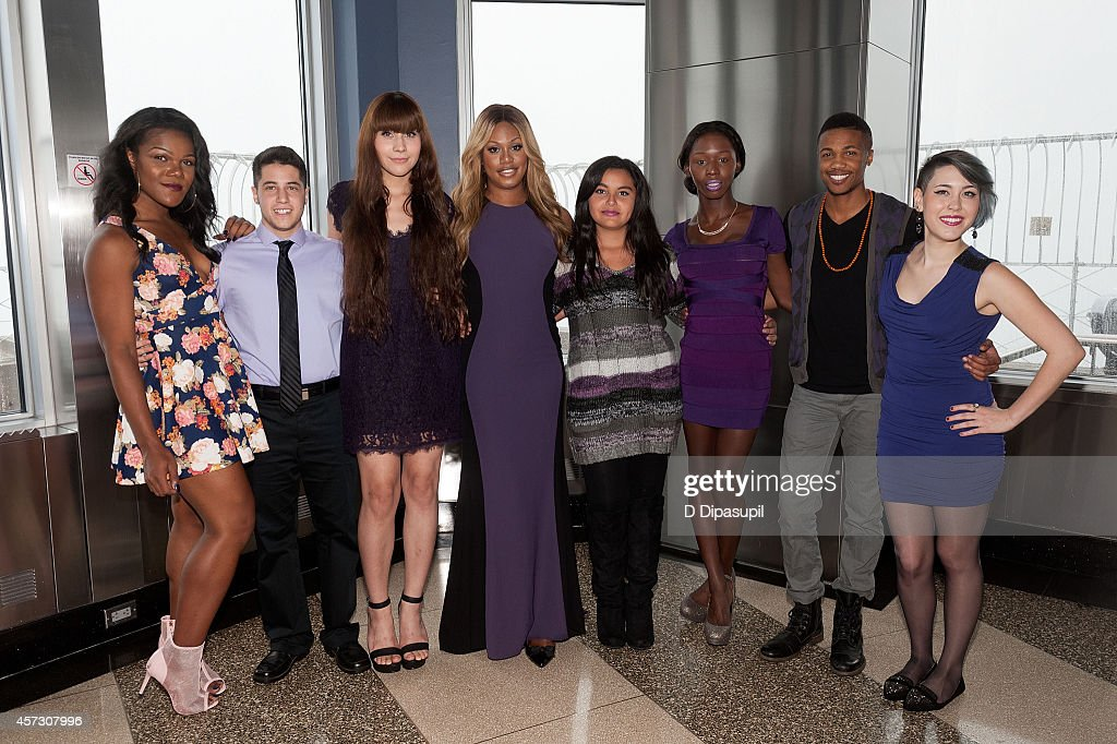 Laverne Cox (4th L) and the cast of MTV and Logo TV's 'The T Word' light The Empire State Building purple honoring Spirit Day and National Bullying Prevention Month at The Empire State Building on October 16, 2014 in New York City.