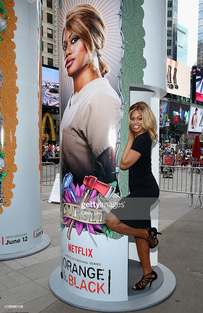 Laverne Cox from the cast of the hit Netflix original series 'ORANGE IS THE NEW BLACK' poses with a giant 14 foot tall candle-shaped photo booth in New York's Times Square on June 10, 2015 in New York City. The interactive photo booths project users' photos on to enormous displays in Times Square. 'ORANGE IS THE NEW BLACK' Season 3 premieres on Friday, June 12.