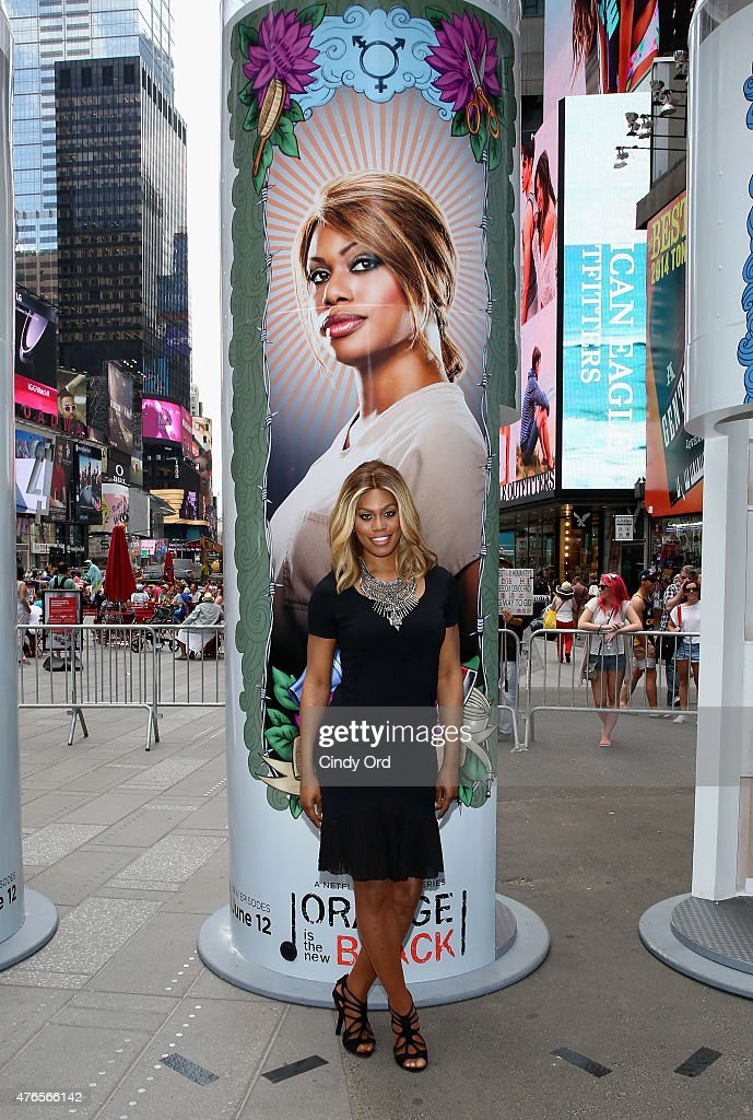Laverne Cox from the cast of the hit Netflix original series 'ORANGE IS THE NEW BLACK' keeps the faith at a giant 14 foot tall candle-shaped photo booth in New York's Times Square on June 10, 2015 in New York City. The interactive photo booths project users' photos on to enormous displays in Times Square. 'ORANGE IS THE NEW BLACK' Season 3 premieres on Friday, June 12.