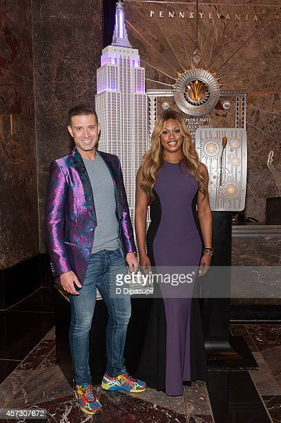 Laverne Cox poses with Omar Sharif Jr as she lights The Empire State Building purple honoring Spirit Day and National Bullying Prevention Month at...