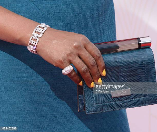 Laverne Cox Purse and Jewelry Detail attends the 67th Annual Primetime Emmy Awards at Microsoft Theater on September 20 2015 in Los Angeles California
