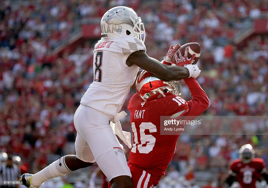 Laverne Jacob #8 of the Maryland Terrapins reaches up to catch a pass while defended by Rashard Fant #16 of the Indiana Hoosiers at Memorial Stadium on October 29, 2016 in Bloomington, Indiana.