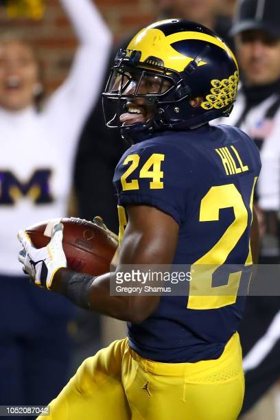 Lavert Hill of the Michigan Wolverines intercepts a second half pass and returns is for a touchdown while playing the Wisconsin Badgers on October 13...
