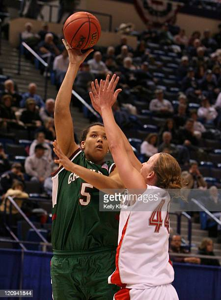 Lavesa Glover puts in the baby hook shot over Julie Briody of New Mexico at the Hartford Civic Center in Hartford CT on March 18 2007