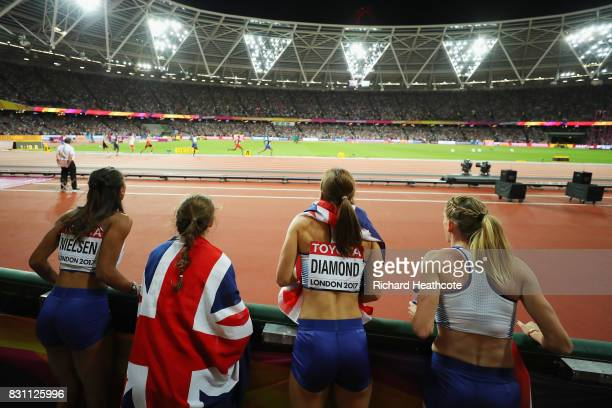 Laviai Nielsen Zoey Clark Emily Diamond and Eilidh Doyle and of Great Britain Women's 4x400 Metres Relay team cheer on their mens counterparts in...