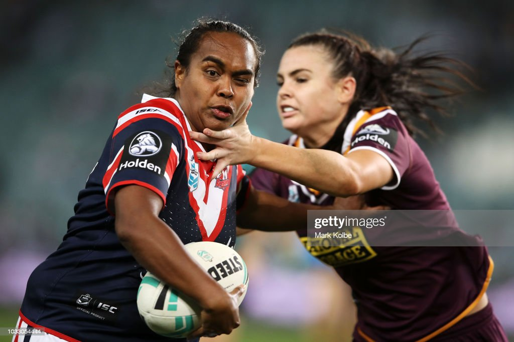 Lavina O'Mealey of the Roosters is tackled by Amber Pilley of the Broncos during the round two Women's NRL match between the Sydney Roosters and the Brisbane Broncos at Allianz Stadium on September 14, 2018 in Sydney, Australia.