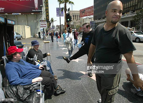 """Star Wars fans amuse themselves as they wait outside the Mann's Chinese Theater in Hollywood 11 April, 2002 for the opening of the movie """"Star Wars..."""