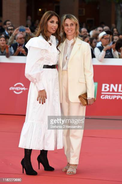 Lavinia Biagiotti and Marianna Madia walk a red carpet during the 14th Rome Film Festival on October 19, 2019 in Rome, Italy.