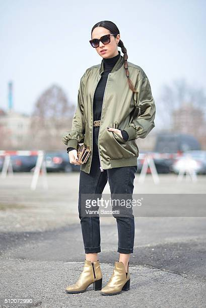 Lavinia Biancalani poses wearing a Varsity bomber jacket before the Gucci show during the Milan Fashion Week Fall/Winter 2016/17 on February 24 2016...