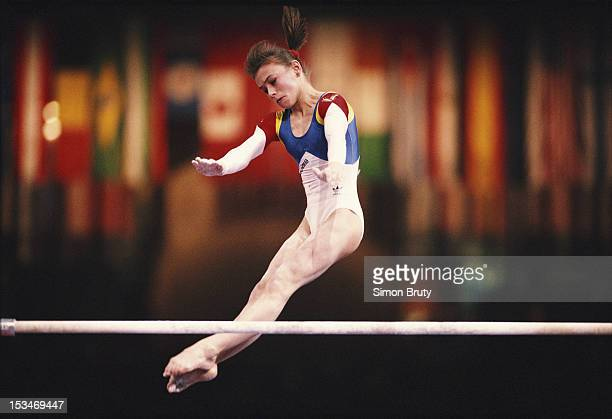Lavinia Milosovici of Romania performs during the Women's Uneven Bars event on 1st October 1992 during the World Artistic Gymnastics Championships at...