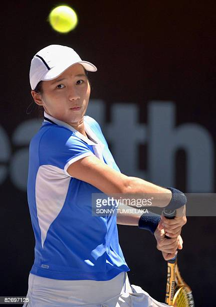 Lavinia Tananta of Indonesia hits a return against compatriot Ayu Fani Damayanti during a qualification round of the Bali international tennis...