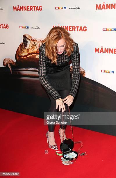 Lavinia Wilson fallen handbag during the premiere for the film 'Maennertag' at Mathaeser Filmpalast on September 5 2016 in Munich Germany