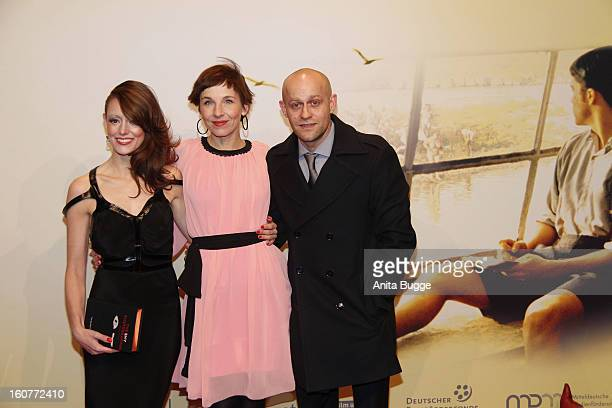 Lavinia Wilson Juergen Vogel and Meret Becker attend the attend 'Quelle des Lebens' Germany Premiere at Delphi Filmpalast on February 5 2013 in...