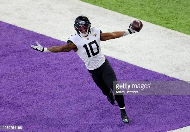 Laviska Shenault Jr. #10 of the Jacksonville Jaguars celebrates his touchdown in the first quarter against the Minnesota Vikings at U.S. Bank Stadium...