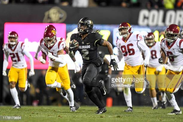 Laviska Shenault Jr #2 of the Colorado Buffaloes carries the ball for a 73yard touchdown catch against the USC Trojans in the third quarter of a game...