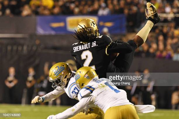 Laviska Shenault Jr top receive the pass from QB Steven Montez against UCLA defense backs Darnay Holmes and Quentin Lake in the 2nd quarter of the...