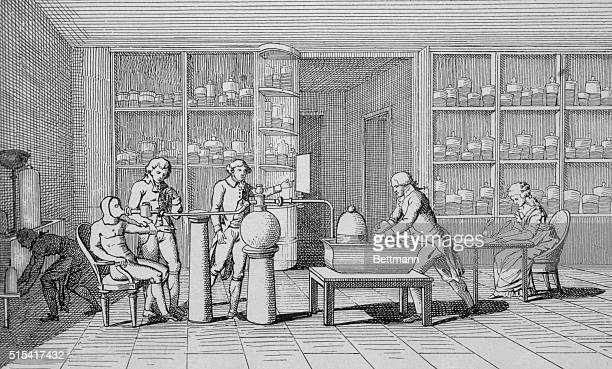 Lavoisier in his laboratory during experiment in respiration At right Madame Lavoisier takes notes