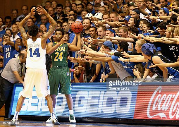Lavon Long of the Siena Saints tries to throw the ball in against Brandon Ingram of the Duke Blue Devils during their game at Cameron Indoor Stadium...