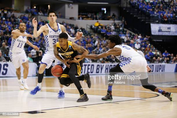 Lavone Holland II of the Northern Kentucky Norse drives to the basket against De'Aaron Fox of the Kentucky Wildcats in the second half during the...