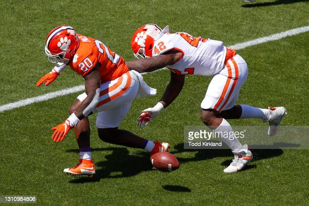 LaVonta Bentley of the Clemson Tigers attempts to pick up the fumbled ball from Kobe Pace during the Clemson Orange and White Spring Game at Memorial...
