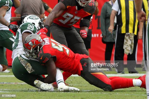 Lavonte David of the Bucs brings down Bilal Powell of the Bucs during the regular season game between the New York Jets and the Tampa Bay Buccaneers...
