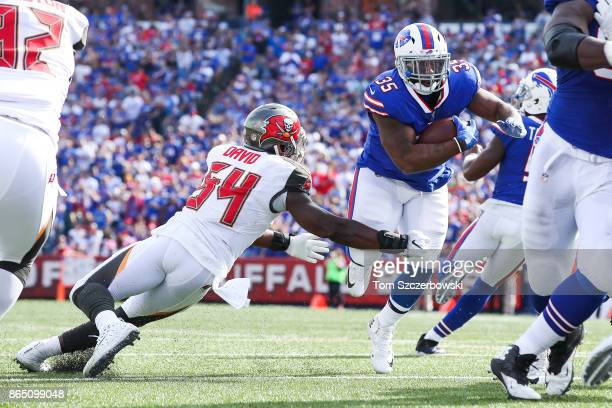 Lavonte David of the Tampa Bay Buccaneers attempts to tackle Mike Tolbert of the Buffalo Bills during the second quarter of an NFL game on October 22...