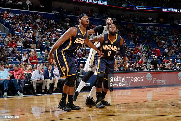 Lavoy Allen and CJ Miles of the Indiana Pacers posts up against Anthony Davis of the New Orleans Pelicans during a preseason game on October 4 2016...