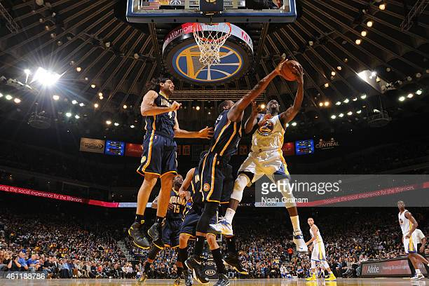 Lavoy Allen of the Indiana Pacers blocks the shot of Draymond Green of the Golden State Warriors on January 7 2015 at Oracle Arena in Oakland...