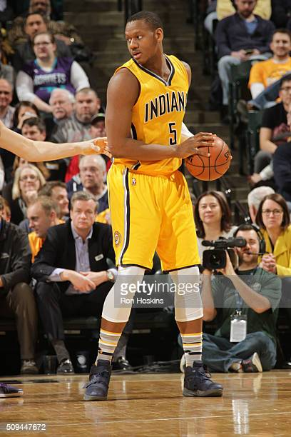 Lavoy Allen of the Indiana Pacers defends the ball against the Charlotte Hornets during the game on February 10 2016 at Bankers Life Fieldhouse in...