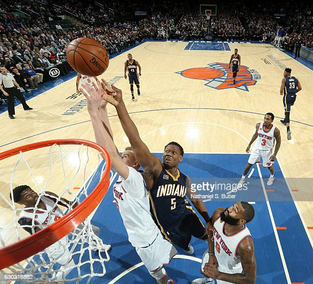 Lavoy Allen of the Indiana Pacers goes up for a rebound against Kristaps Porzingis of the New York Knicks during a game n December 20 2016 at Madison...