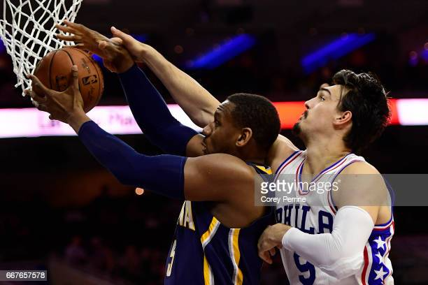 Lavoy Allen of the Indiana Pacers is defended by Dario Saric of the Philadelphia 76ers during the fourth quarter at the Wells Fargo Center on April...