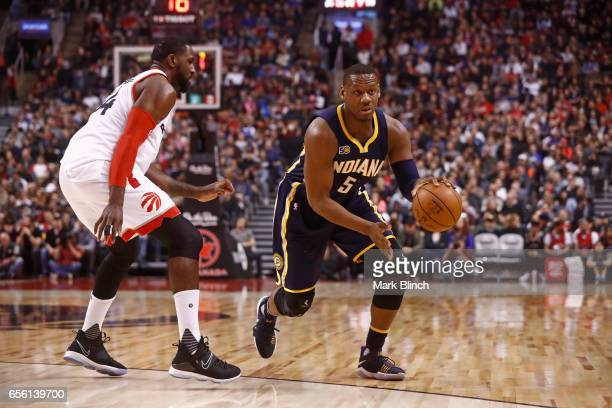 Lavoy Allen of the Indiana Pacers looks to pass the ball against the Toronto Raptors on March 19 2017 at Air Canada Centre in Toronto Ontario Canada...