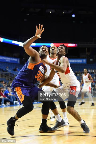 Lavoy Allen of the Northern Arizona Suns and Tyler Roberson of the Agua Caliente Clippers of Ontario react to a play during the game on February 11...