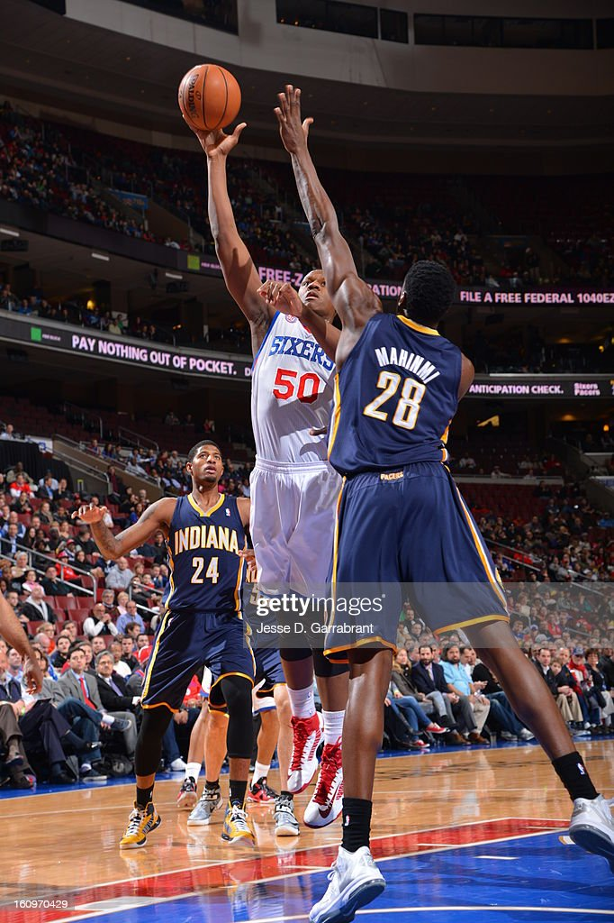 Lavoy Allen #50 of the Philadelphia 76ers drives to the basket Ian Mahinmi #28 of the Indiana Pacers at the Wells Fargo Center on February 6, 2013 in Philadelphia, Pennsylvania.