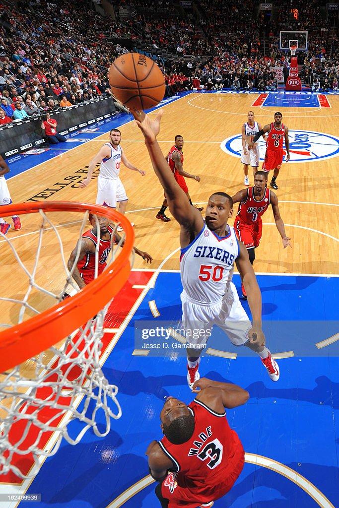 Lavoy Allen #50 of the Philadelphia 76ers shoots against Dwyane Wade #3 of the Miami Heat at the Wells Fargo Center on February 23, 2013 in Philadelphia, Pennsylvania.