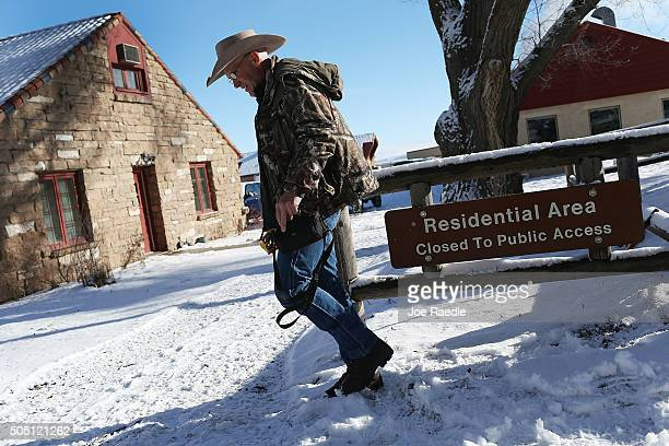 Lavoy Finicum walks through the compound as he and others occupy the Malheur National Wildlife Refuge headquarters on January 15 2016 near Burns...