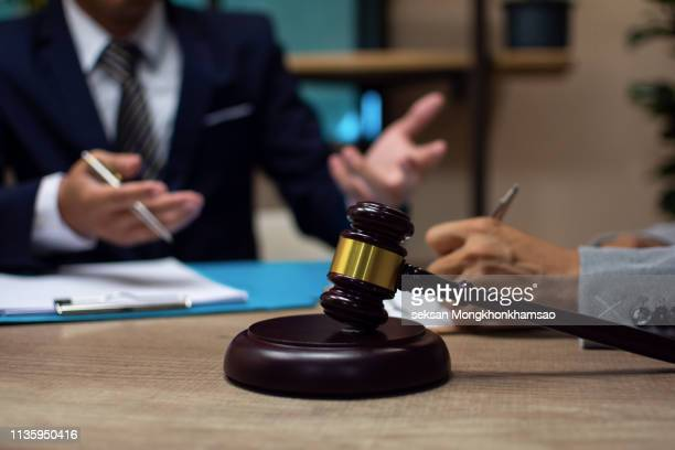 law, advice and legal services concept. lawyer and attorney having team meeting at law firm - auction stock pictures, royalty-free photos & images